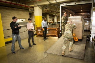 Joint Forces servicemen work with National Archives staff to move President Obama administartion records from storage at the National Archives in Washington, DC, on October 27, 2016.