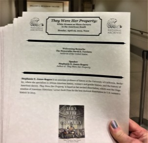 Maarja with programs for Stephanie E. Jones-Rogers book talk, 29 April 2019